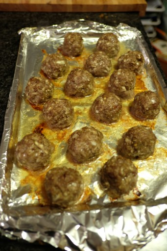 Meatballs are out of the oven and ready to join the sauce.